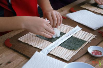 Kids rolling their own sushi