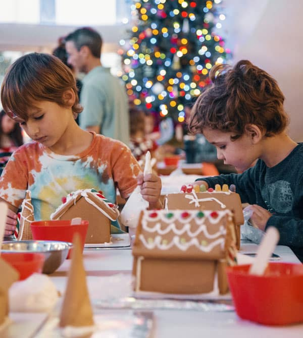 Image of boys decorating Gingerbread Houses
