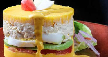 Seafood Causa with Huancaina Sauce
