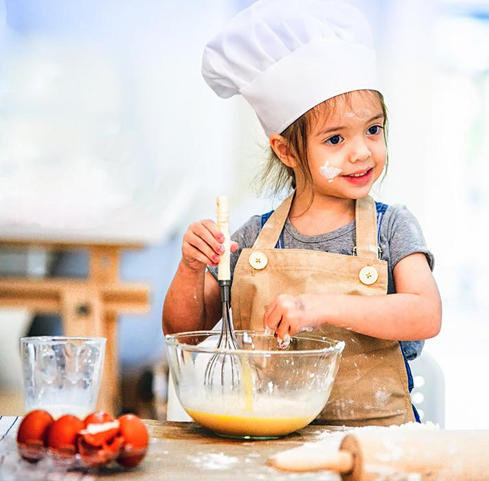 Image of small chef preparing a batter